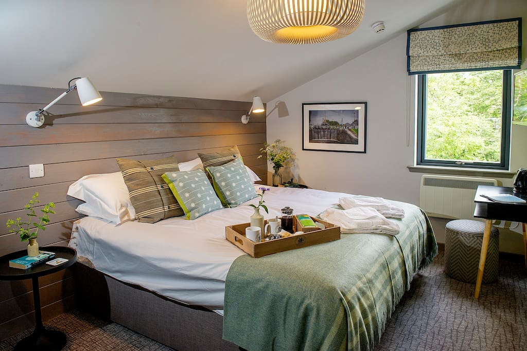 Neptune; sleeps 2 people with the option of a double bed or twin beds and offers an en-suite bathroom with bath and shower.