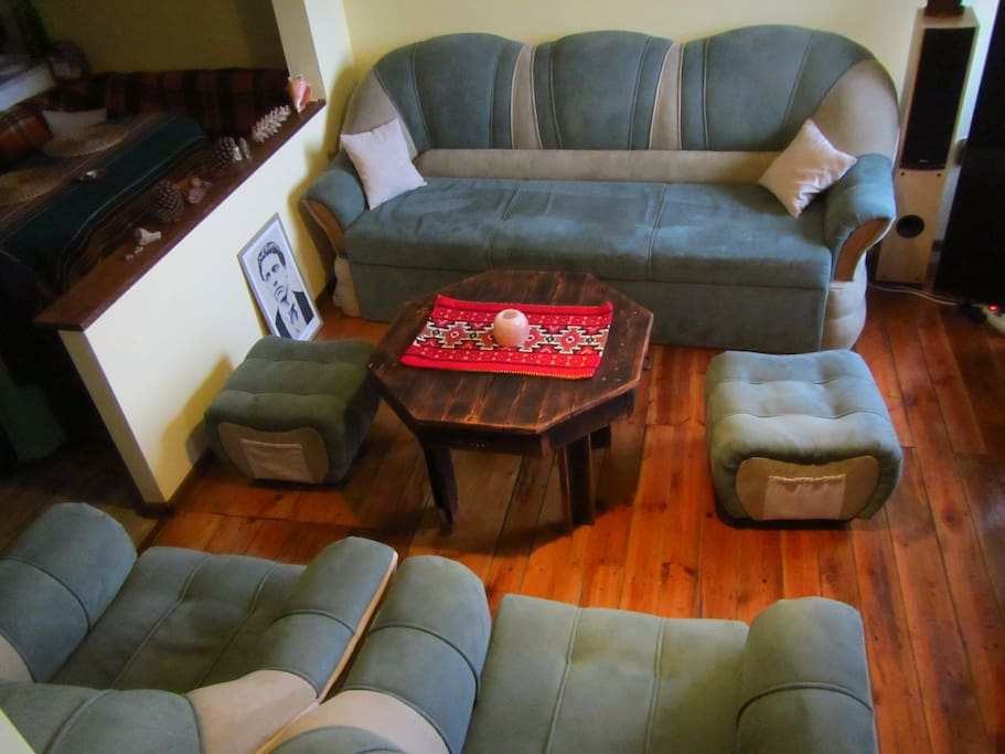 The big sofa can fit two persons.  That is the living room as well.