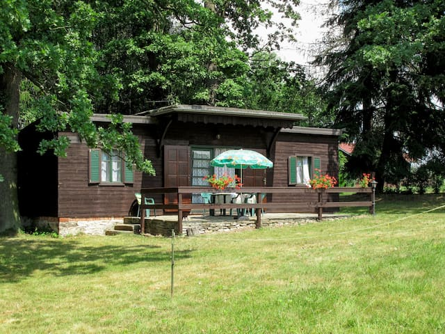 Rustic wooden house located in a rural location, about 50m from Lake Spinka