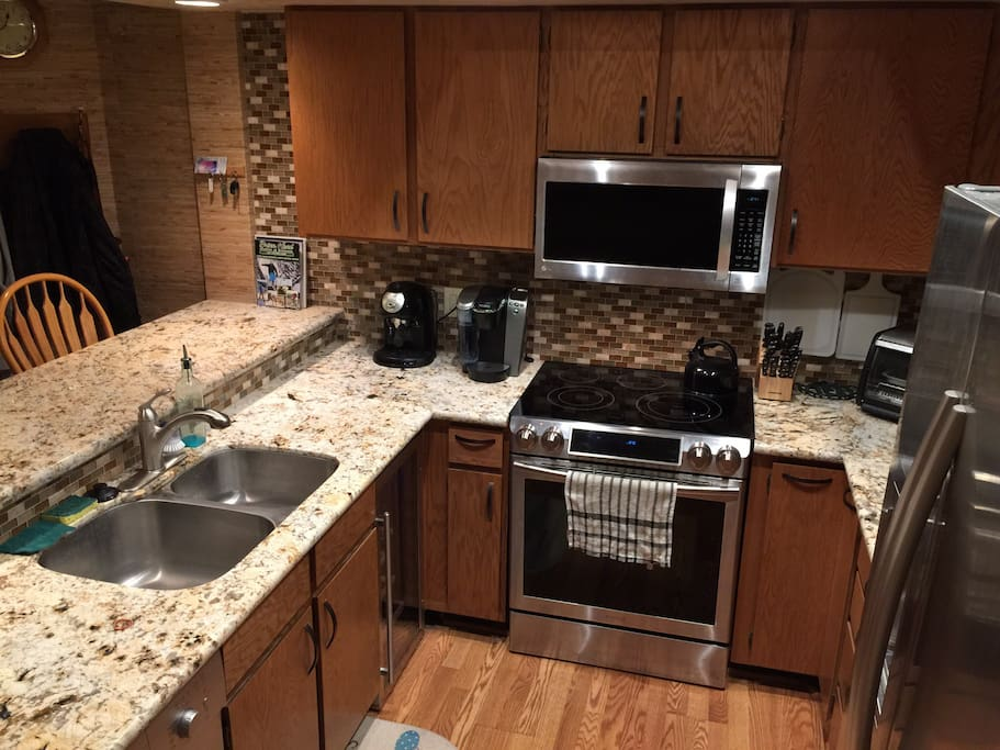 New 2016 upgraded kitchen with all your needs including a stocked wine fridge.