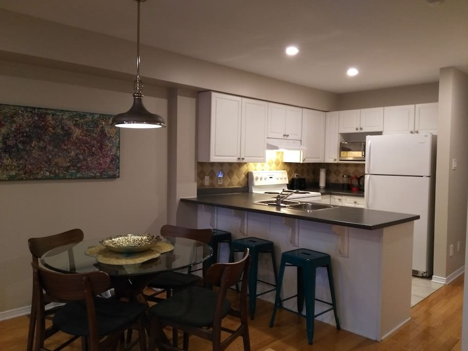 Open concept kitchen/dining/living space