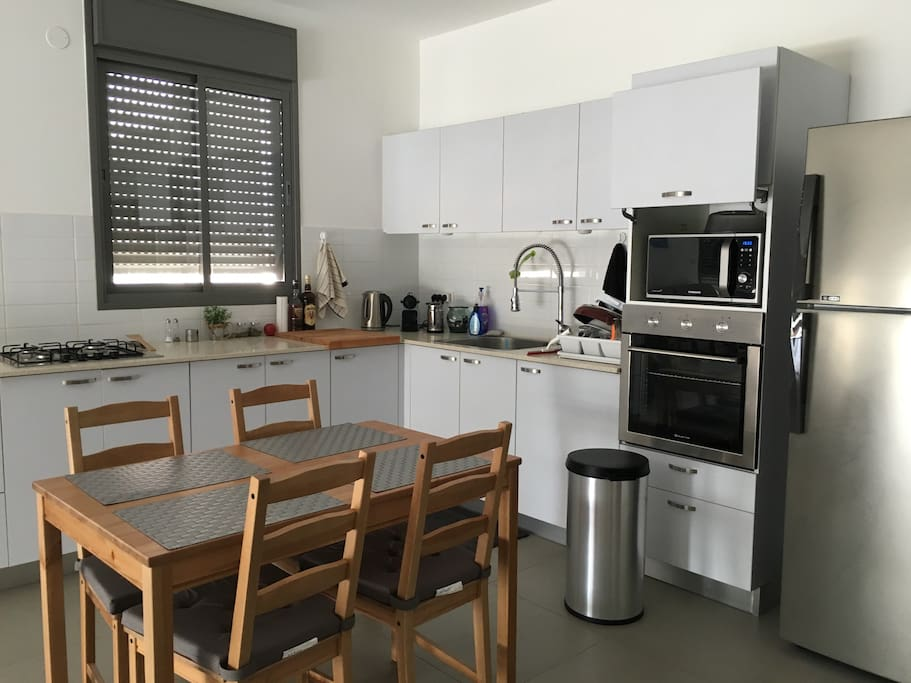 An equipped kitchen with free access to the Nespresso machine and kitchen utilities