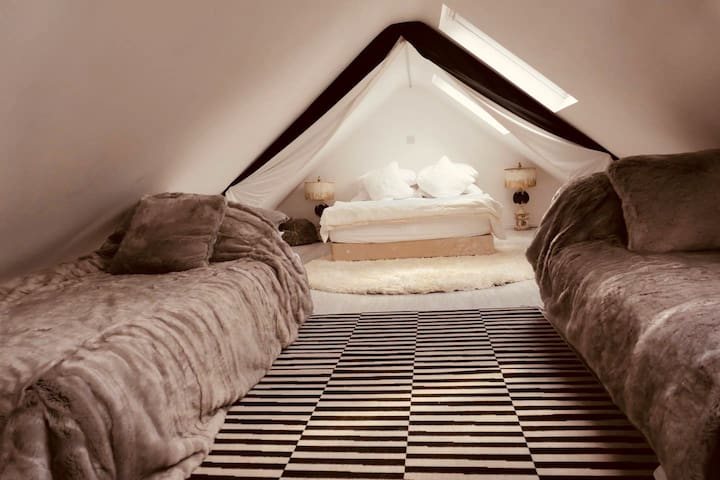 Cosy double bedroom area with two additional beds, all upstairs.