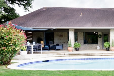 Relax Poolside at a Luxurious Creekfront Home in Round Rock