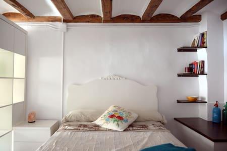 Habitació en una casa de tàpia i fusta - Torregrossa