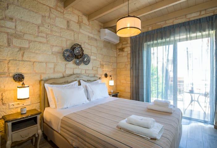 First floor: Bedroom with queen bed