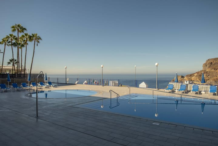 Taurito pool and terrace overlooking the sea by Lightbooking