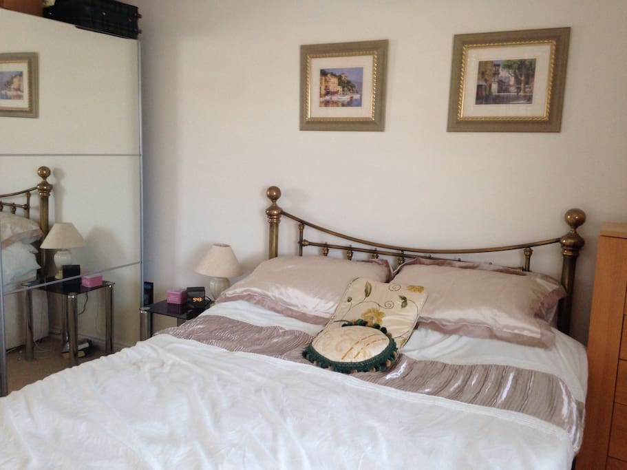 Master bedroom with double wardrobe and chest of drawers space for your clothes if you want to put them away