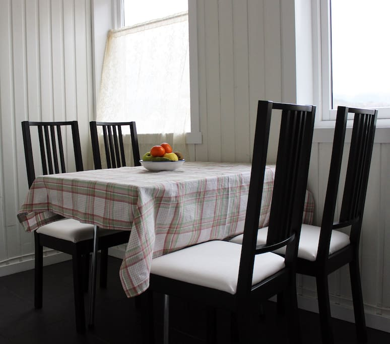 A retro eating table with four chairs.