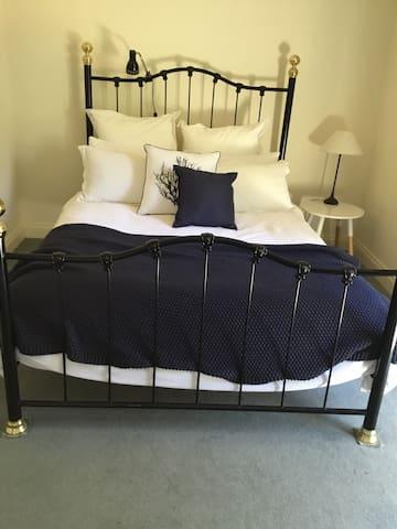Ground floor. Bedroom 1 with Queen bed