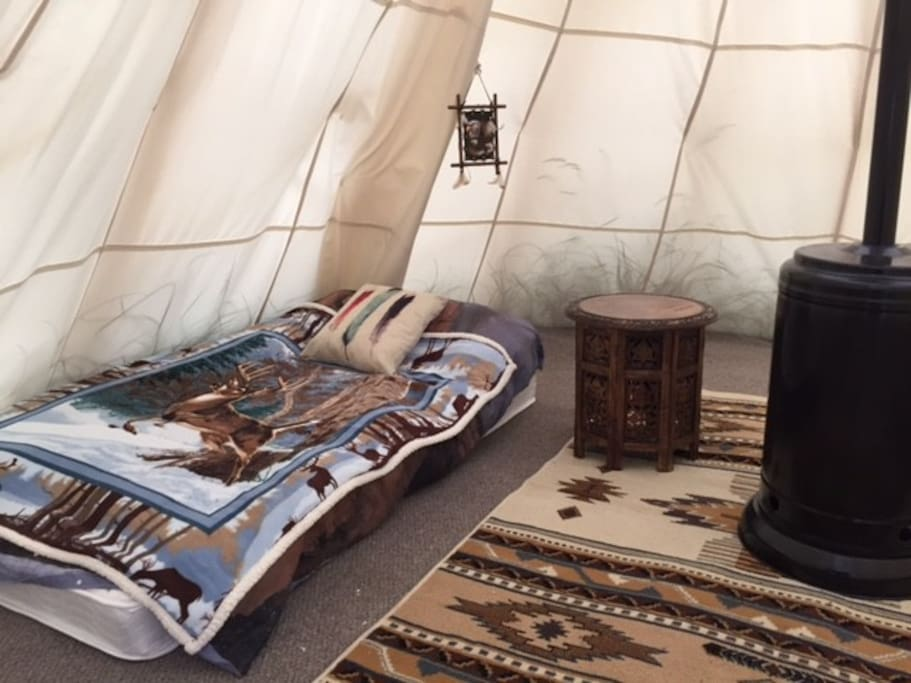 Inside tipis we have twin and full beds available