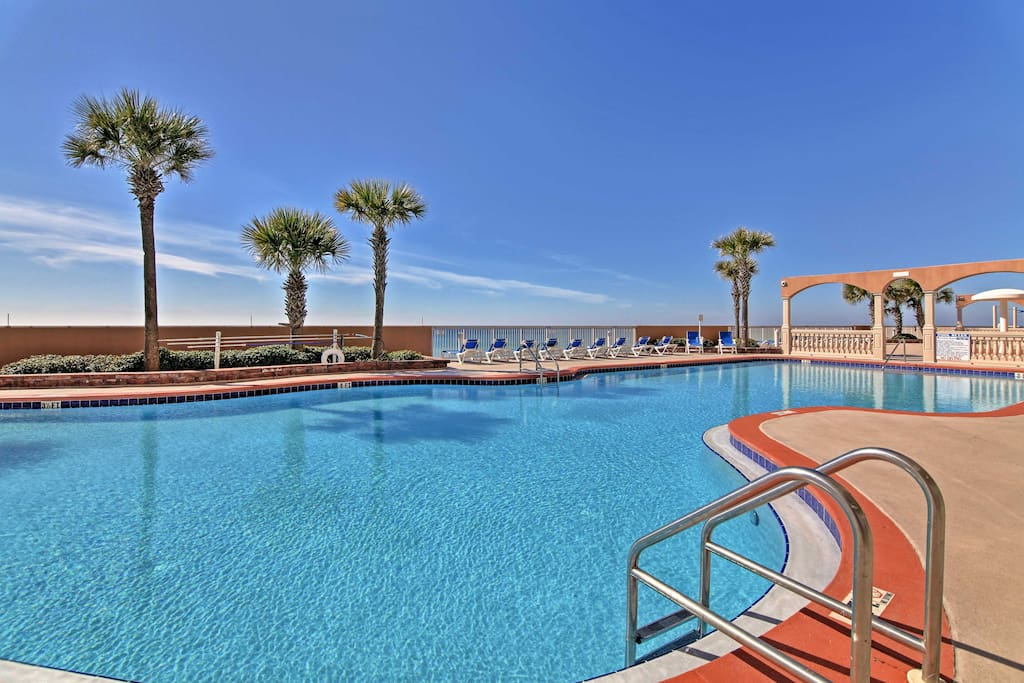 This condo grants guests access to a pool, fitness center, and beach access!