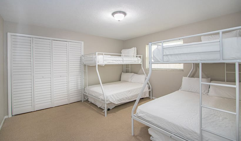 """Bunk room. Each bunk bed has a twin over full w/ a full trundle bed underneath. There is also a 40"""" Samsung Smart TV w/ Spectrum Cable"""