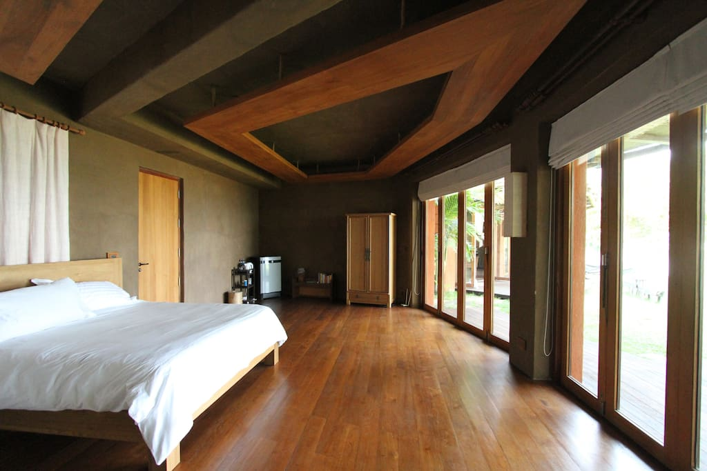 Recycled Teak floors and adobe walls. It's said adobe gives off negative ions which give off good calming energy.
