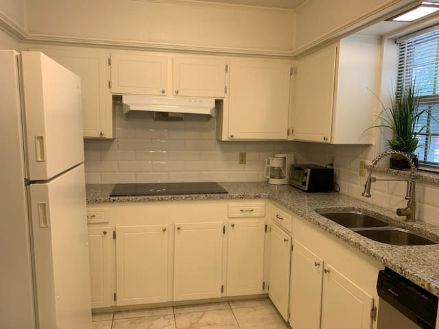 Kitchen with new granite counter top.