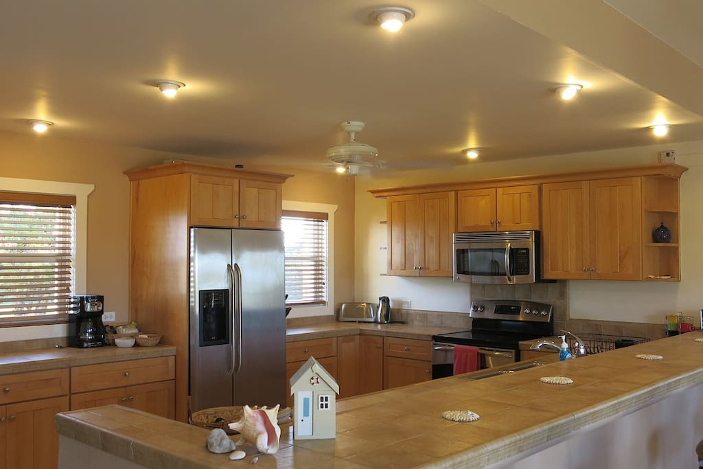 fully equipped kitchen with dishwasher oven and microwave