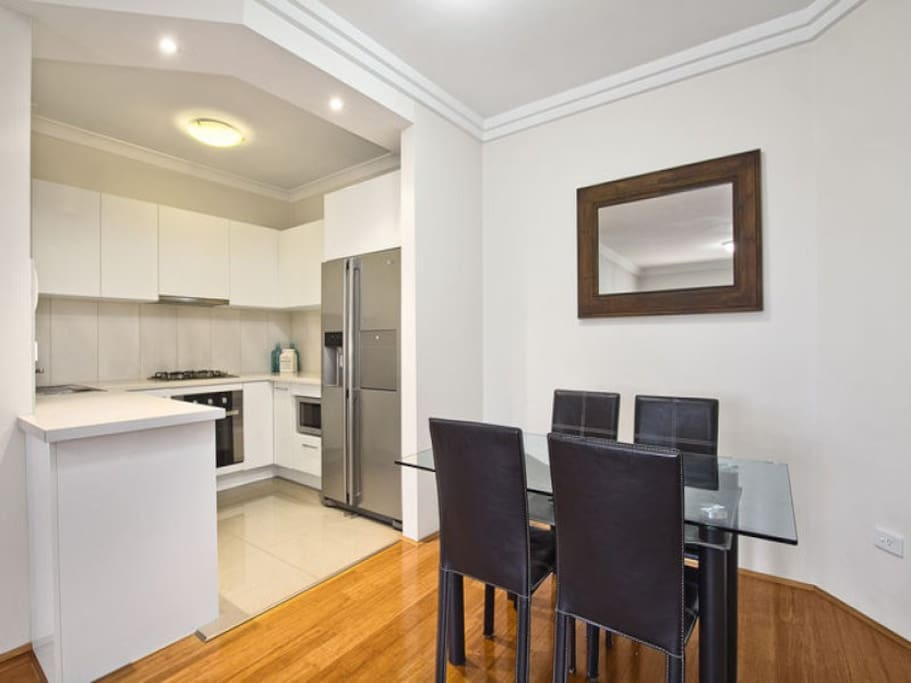 Beautifully renovated kitchen with gas stove and dishwasher