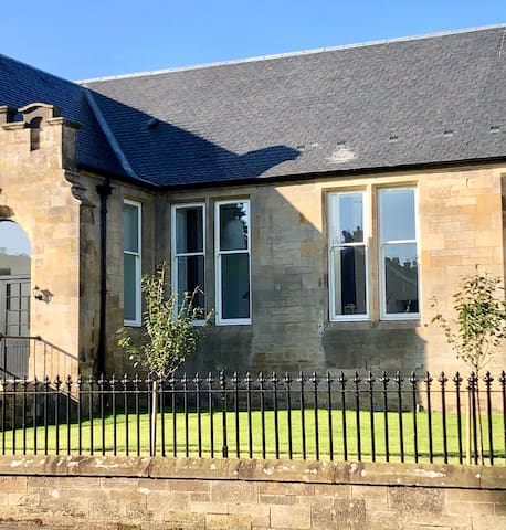 The Old Schoolhouse, an iconic building within the charming town of Kinross. Set back from the High Street in a fairly quiet position in a residential neighbourhood - 5/10 minute walk from shops, restaurants, cafes, gold course etc.