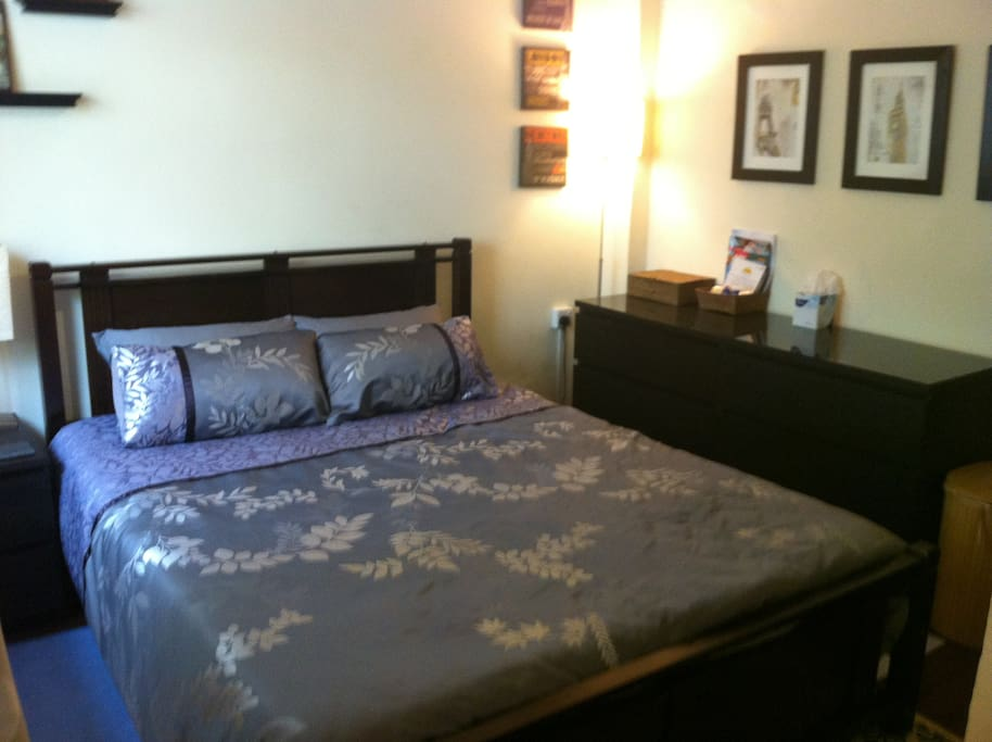 Queen bed with excellent firm mattress and top quality bed linens