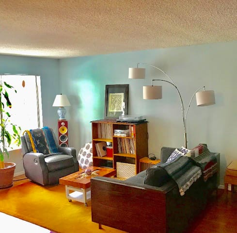 Large living room with high end sound system and over 1000 new and old vinyl records to spin and set the mood.