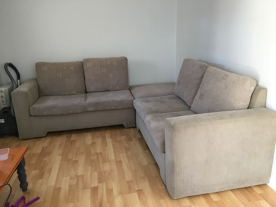 Lounge room with pull out double bed in couch.