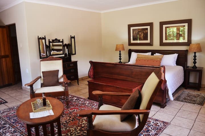 Woodlands Escape Suite 3- Bedroom and Seating Area
