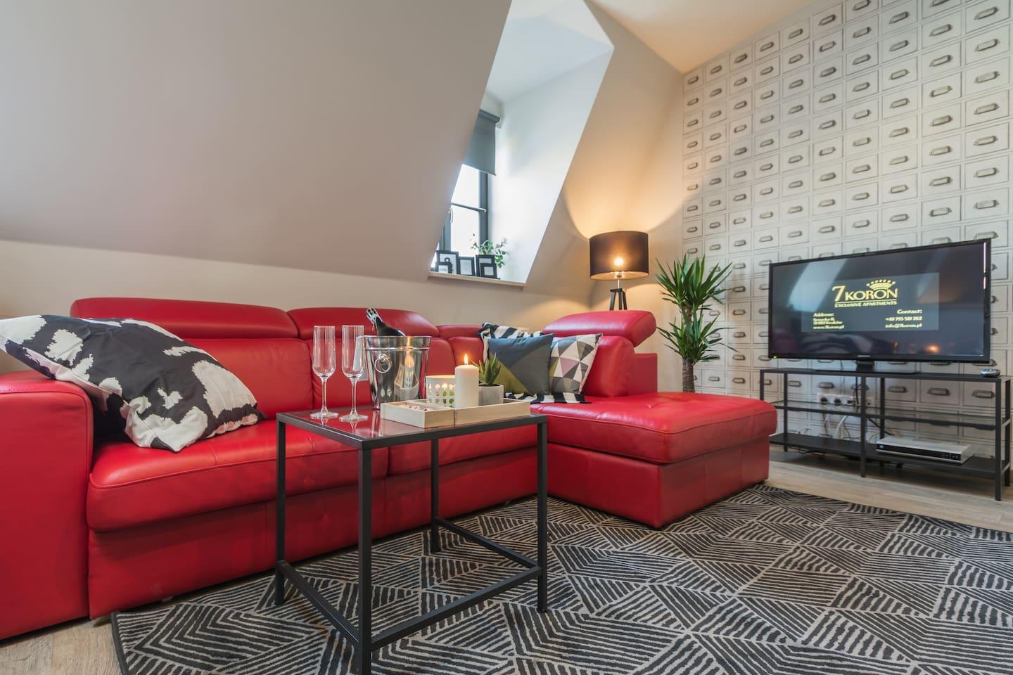 Cozy studio style with expendable sofa and sitting area.