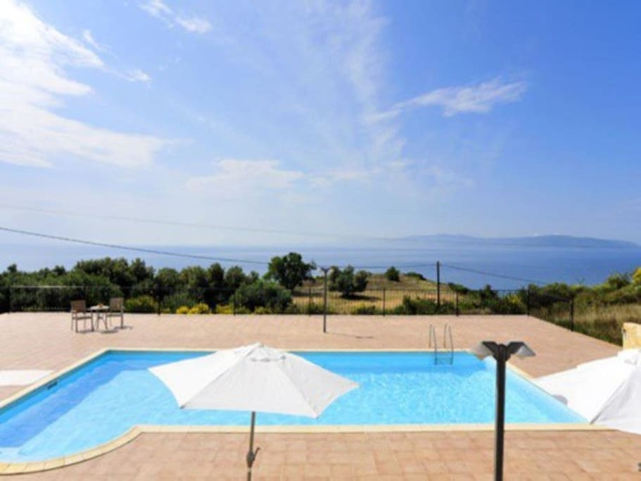 Large pool overlooking the sea and the island if Zante
