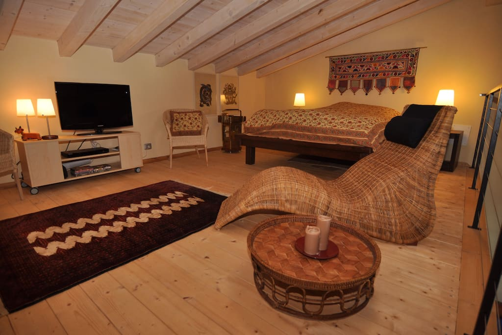 Open loft with bed and TV