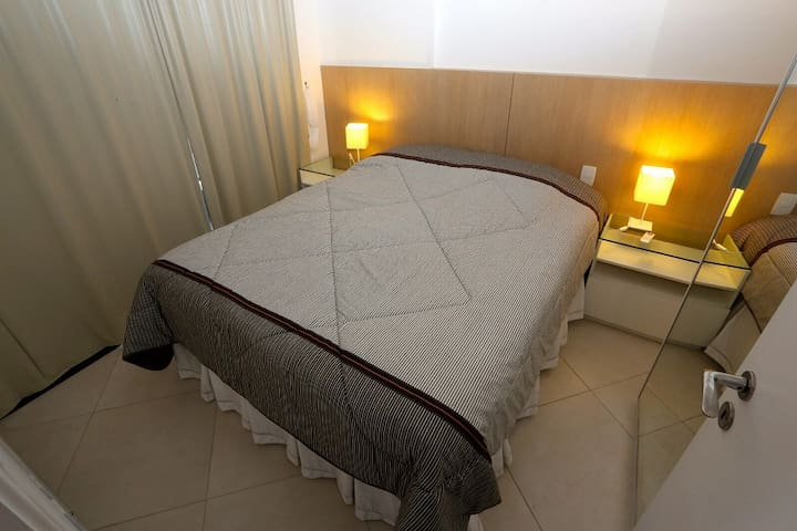 Bedroom with Queen Size bed, balcony access and Air Condition