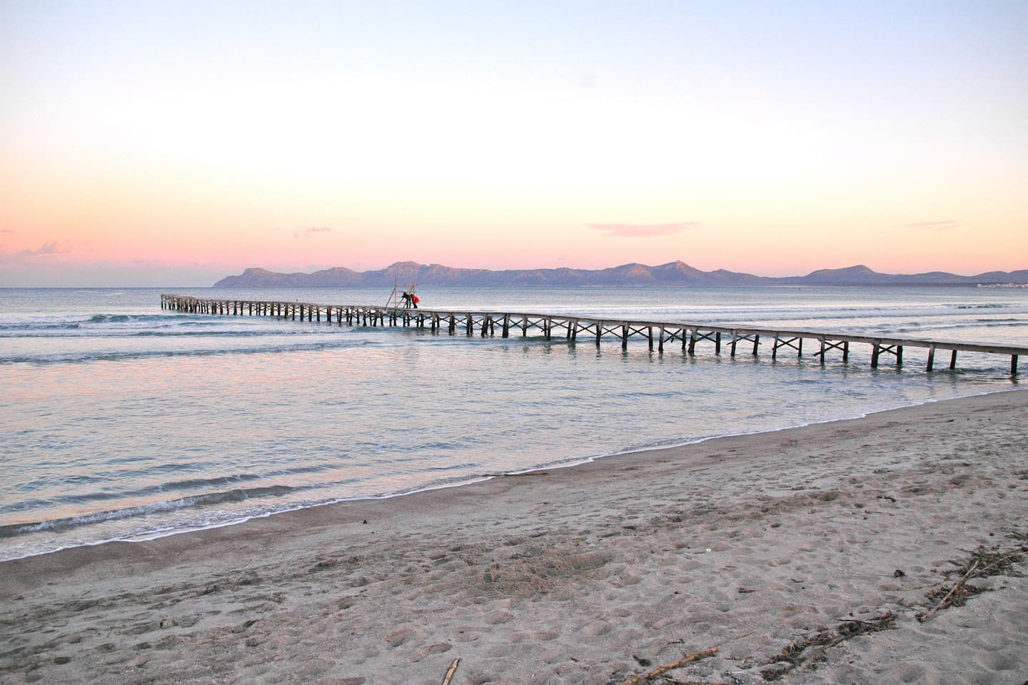 Platja d'alcudia/ Platja de Muro.  Large, calm, sandy beach 300 metres from our apartment.  Really safe for children because it is so shallow. We love to walk along at sunrise and sunset both in summer and winter.