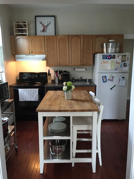 Kitchen includes appliances and wares including dishwasher and microwave