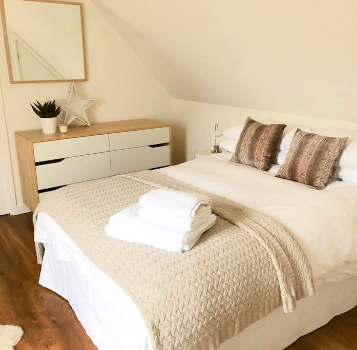 Bedroom with Egyptian cotton sheets and duck down duvet and pillows