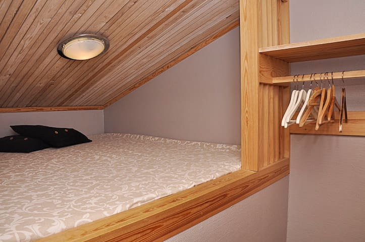 Loft-room with bed for 2 persons.