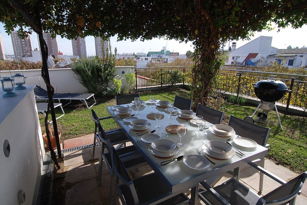 Jerez Town House Holiday Rental - Upstairs roof garden with rooftop views of Jerez. Dine al fresco under the purpose-built pergola.