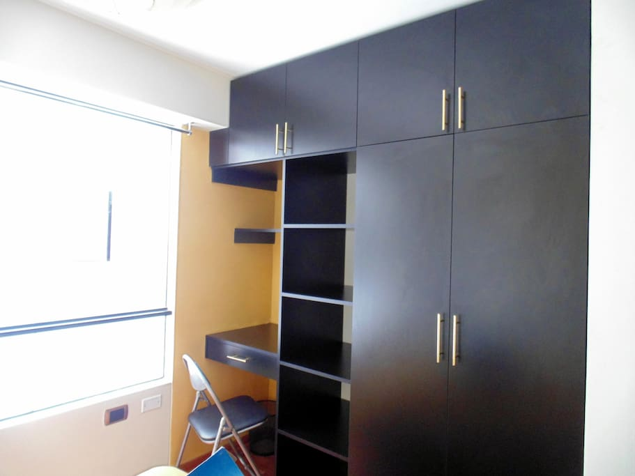 Closets and laptop area in 2nd Bedroom