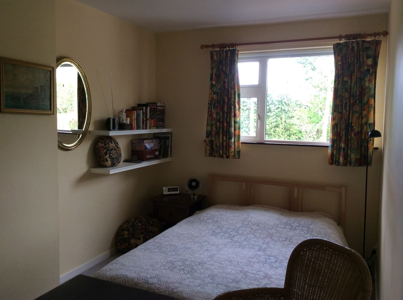 A bright room with a double bed