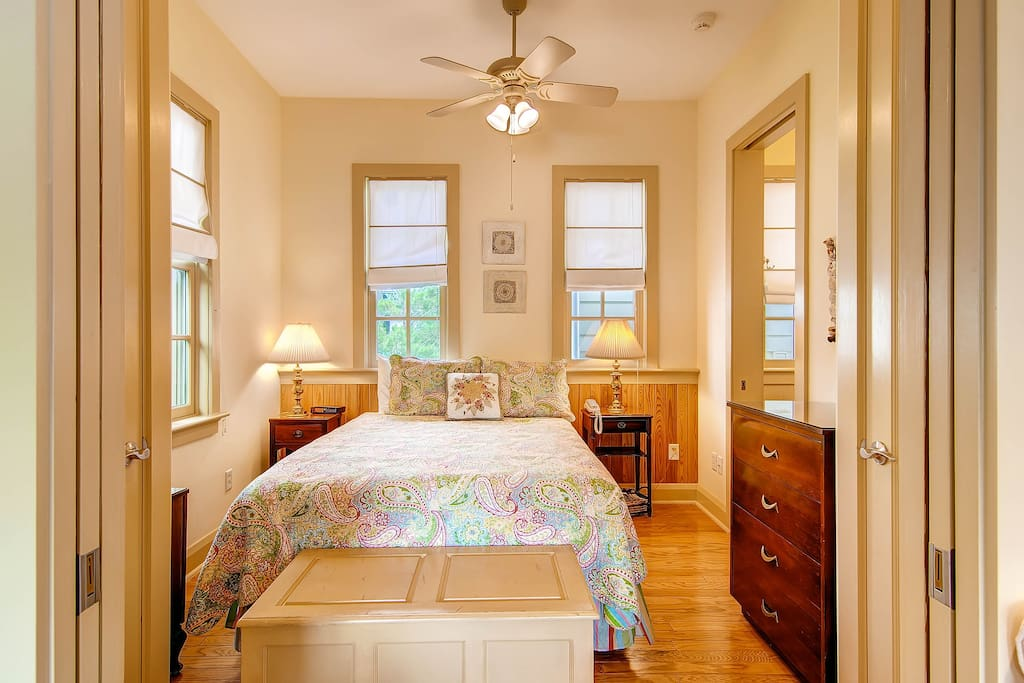 The master bedroom has a queen bed, private bath, and flatscreen TV