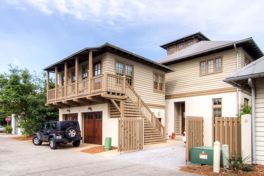 The exterior of the carriage house: access is up the stairs on the balcony