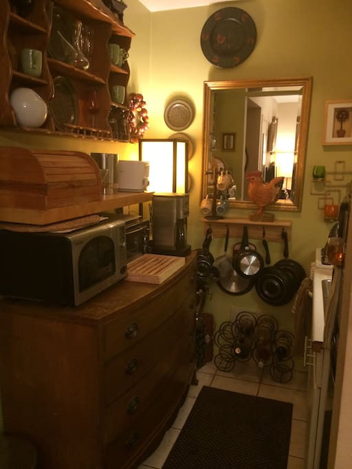 Stove and Refrigerator, Microwave, dishes, cutlery, and cookware