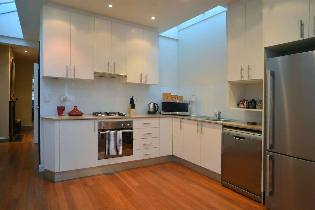 Large fridge, oven, dishwasher, gas cooktop.