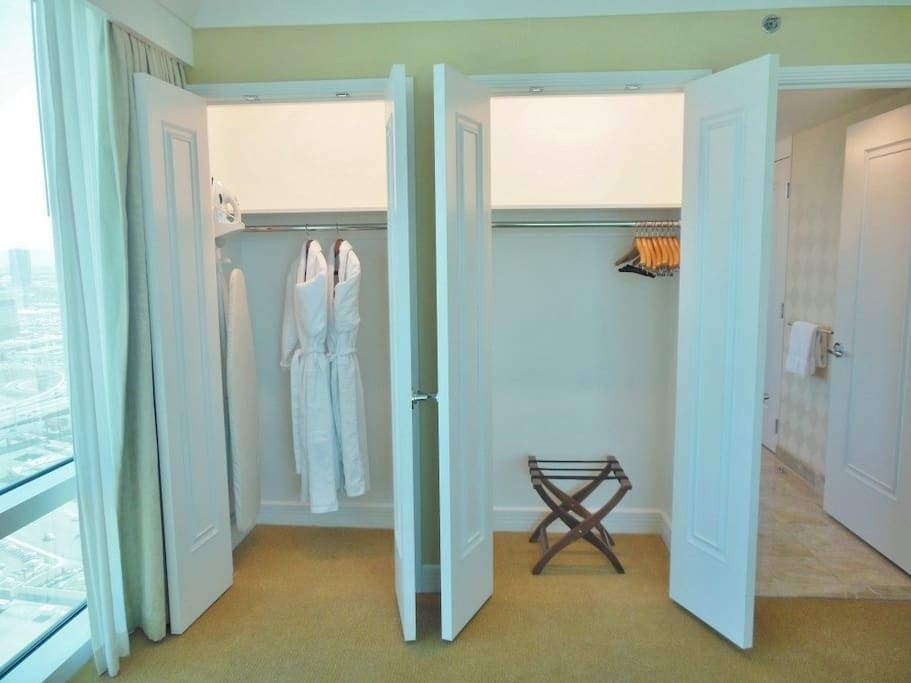 The bedroom is beautifully appointed with two separate walk-in-closets