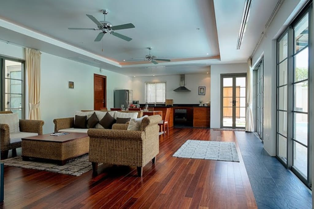 Living and dining area, fully equiped kitchen, bedroom and bathroom entrances