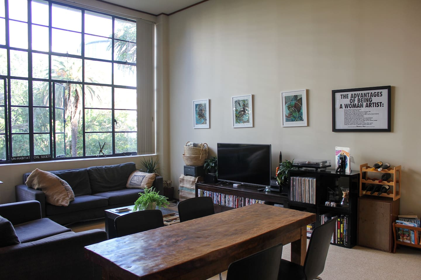 Our living room with views over Myers Park.  You're welcome to use our TV and watch DVDs, and you can use the record player too - just please ask us to show you how first! Our dining table is from a cafe that recently closed down after nearly 20 years - it was a local institution.