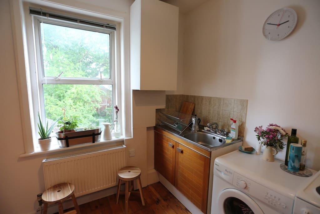 Kitchen with washer and dryer and nice view of the garden