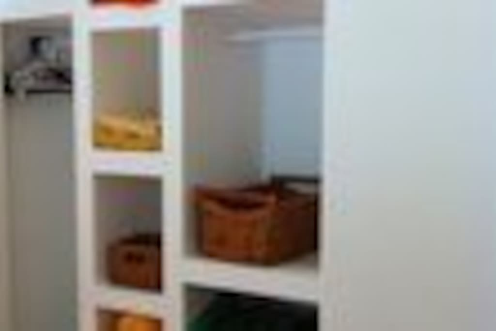 Open shelves next to bed