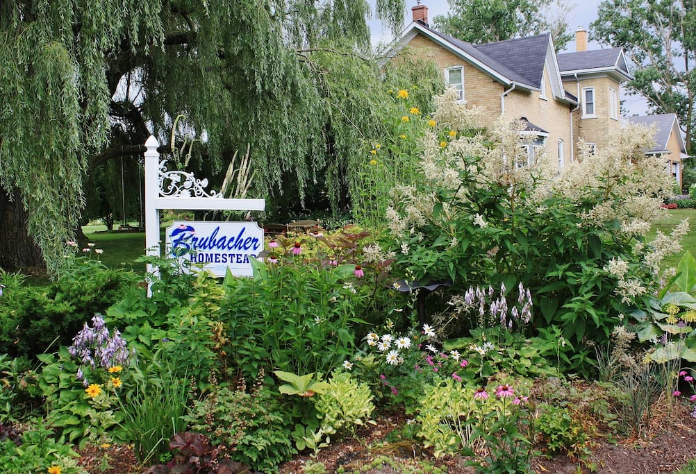Rural B&B on the edge of town with manicured flower gardens.