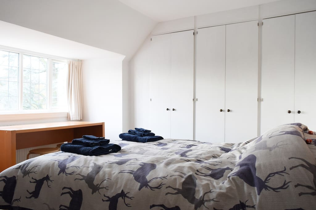 Bedroom 1 - Enjoy the view from the south facing window overlooking the large meandering garden and park beyond.
