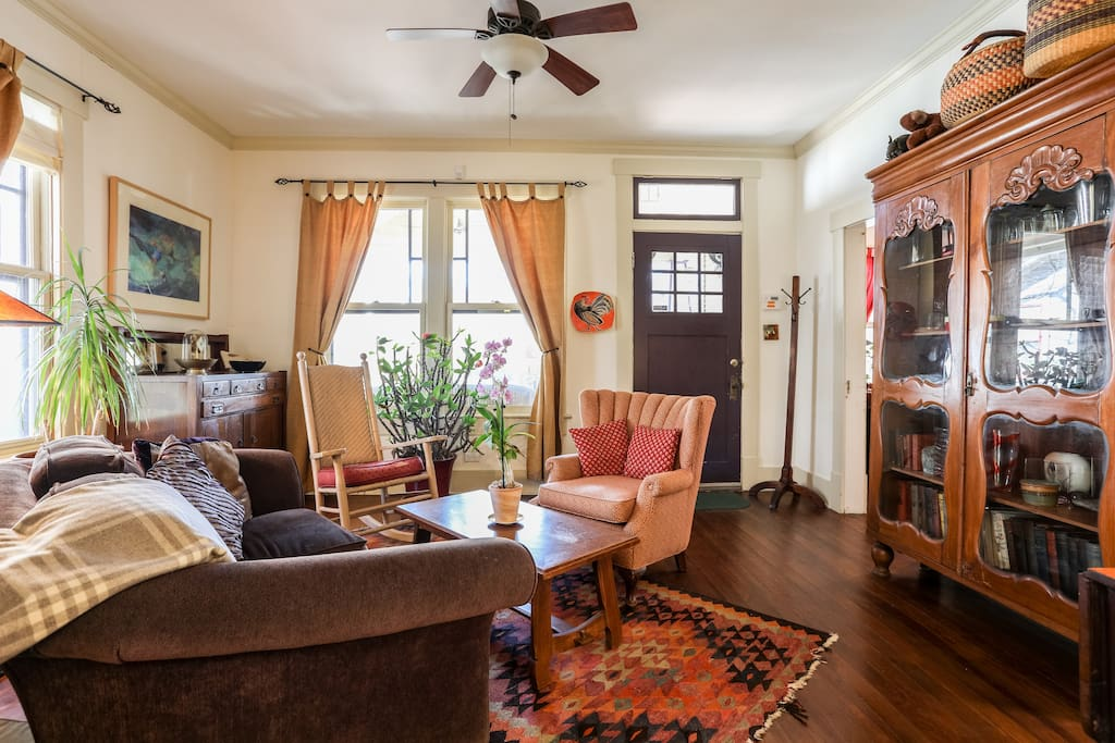 Relax in the cozy living room with eclectic art and vintage furniture