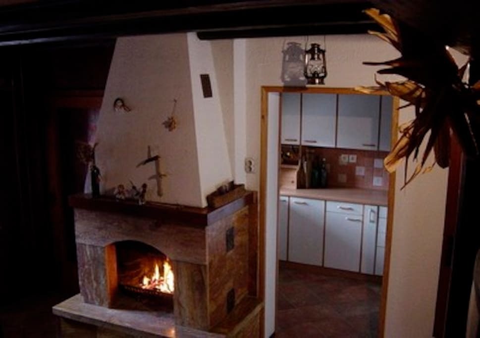 Fire place with kitchen in the background